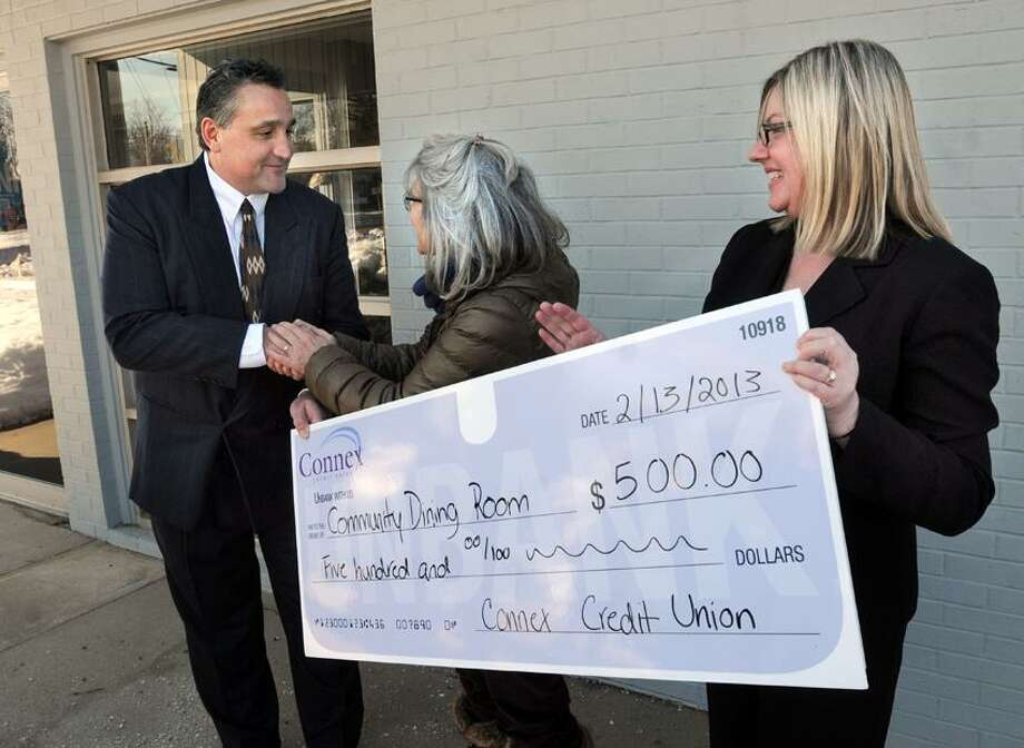 Connex Credit Union has opened a branch in Branford and donated $500 to Branford's Community Dining Room. Connex president and CEO Frank Mancini. left. Community Dining Room's Pat Kral, and Guilford/Branford branch manager Melissa O'Connor right. Mara Lavitt/New Haven Register2/13/13