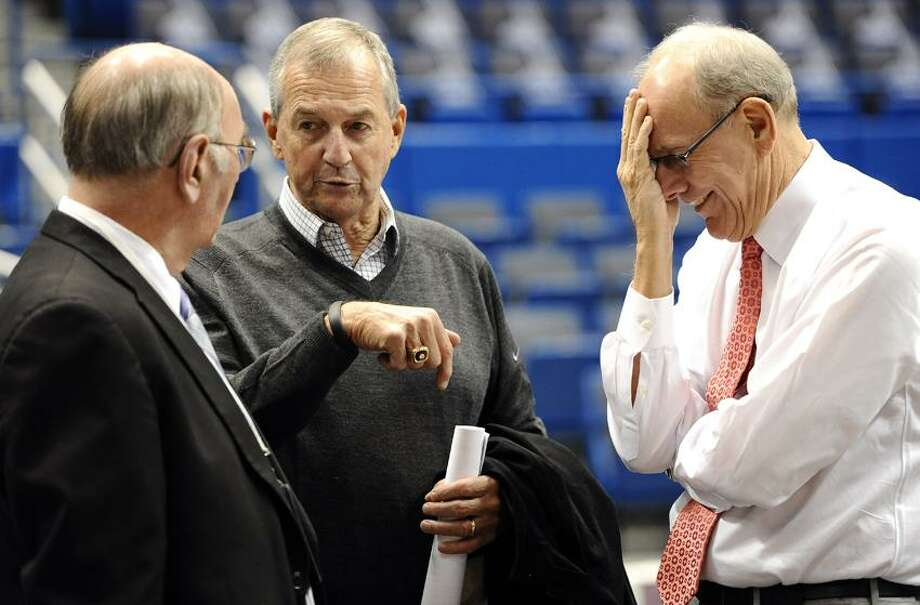 Former Connecticut head coach Jim Calhoun, center, speaks with Associated Press writer Jim O'Connell, left, as Syracuse head coach Jim Boeheim, right, reacts, before an NCAA college basketball game between the two teams in Hartford, Conn., Wednesday, Feb. 13, 2013. (AP Photo/Jessica Hill) Photo: AP / FR125654 AP