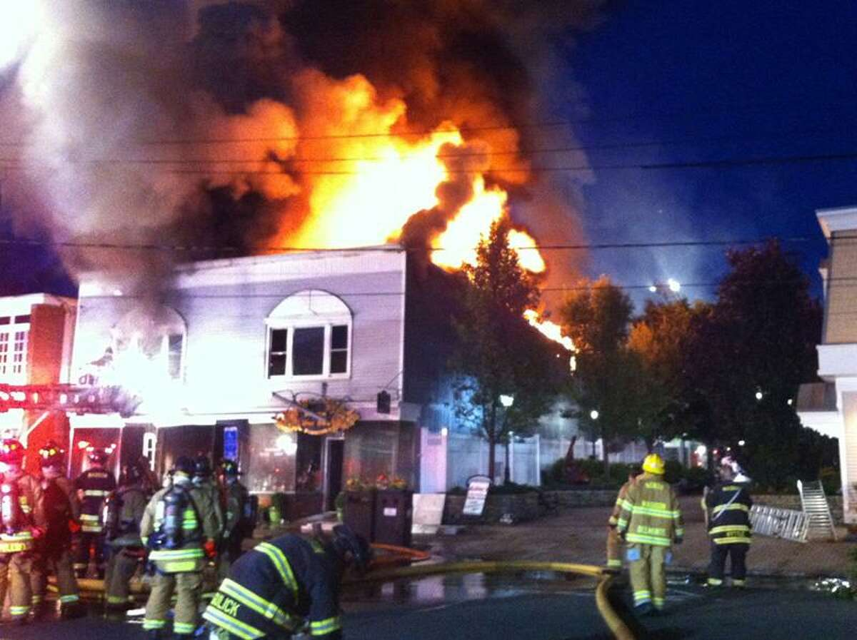Firefighters fight a fire on Main Street in Madison. Contributed photo