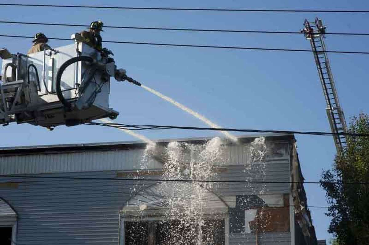 Firefighters fight a fire on Main Street in Madison. VM Williams/Register