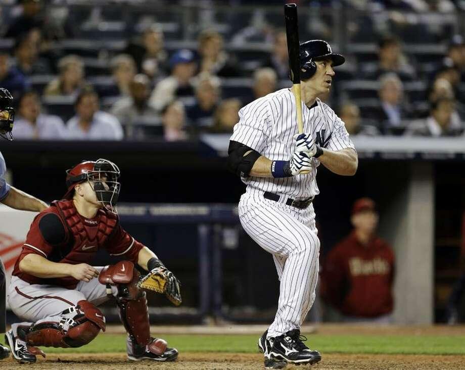 New York Yankees designated hitter Travis Hafner watches his eighth-inning solo home run in a baseball game against the Arizona Diamondbacks at Yankee Stadium in New York, Wednesday, April 17, 2013. (AP Photo/Kathy Willens) Photo: AP / AP