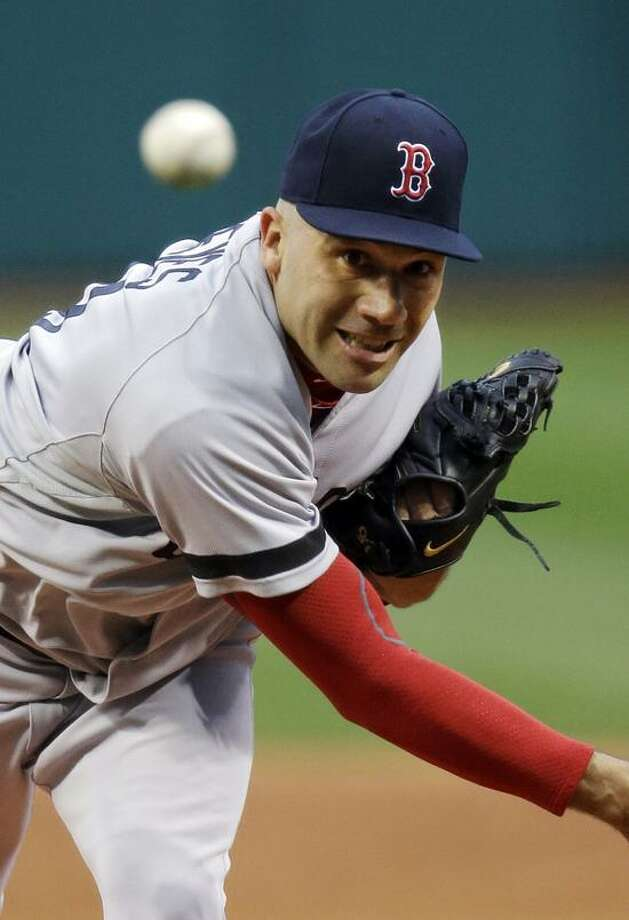 Boston Red Sox starting pitcher Alfredo Aceves delivers against the Cleveland Indians in the first inning of a baseball game Wednesday, April 17, 2013, in Cleveland. (AP Photo/Mark Duncan) Photo: AP / AP