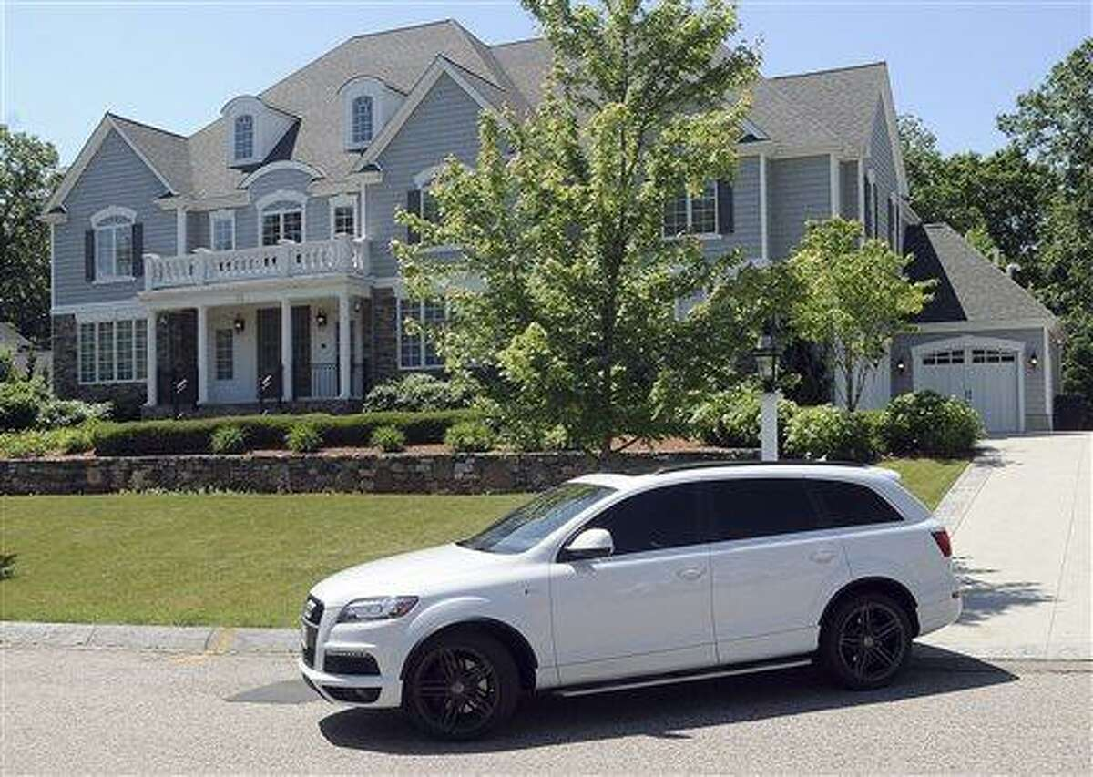 New England Patriots tight end Aaron Hernandez drives from his home late Thursday morning, June 20, 2013, in North Attleborough, Mass. Hernandez had a connection to homicide victim Odin Lloyd, of Boston, whose body was found in an industrial park near the athlete's home. Family and officials were mum on the nature of their relationship Thursday, two days after police visited Hernandez' home. (AP Photo/The Sun Chronicle, Mark Stockwell) MANDATORY CREDIT. MAGAZINES OUT.