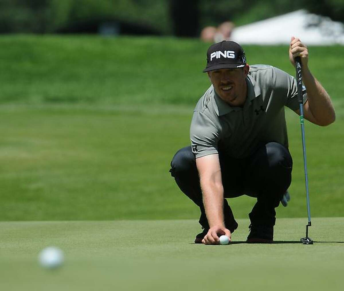 Peter Hvizdak Ñ RegisterHunter Mahan lines up his putt at the 9th Hole during first round of golf Thursday June 20, 2013 of the PGA 2013 Travelers Championship at the Tournament Players Club River Highlands in Cromwell, Conn.
