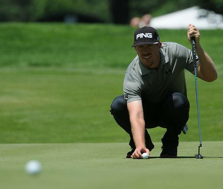 Peter Hvizdak Ñ RegisterHunter Mahan lines up his putt at the 9th Hole  during first round of golf Thursday June 20, 2013  of the PGA  2013 Travelers Championship  at the Tournament Players Club River Highlands in Cromwell, Conn. Photo: New Haven Register / ©Peter Hvizdak /  New Haven Register