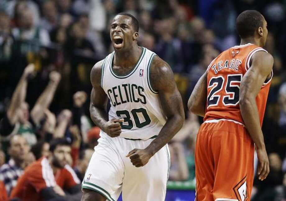 Boston Celtics forward Brandon Bass (30) celebrates after scoring as Chicago Bulls guard Marquis Teague (25) looks on during the fourth quarter of an NBA basketball game in Boston, Wednesday, Feb. 13, 2013. The Celtics won 71-69. (AP Photo/Elise Amendola) Photo: AP / AP
