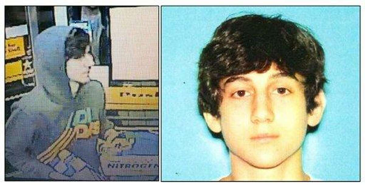 This image provided by the Boston Regional Intelligence Center shows Dzhokhar A. Tsarnaev, identified by the FBI as suspect number 2, in the Boston Marathon bombings. Authorities say Tsarnaev is still at large after he and another suspect, both identified to The Associated Press as coming from the Russian region near Chechnya, killed an MIT police officer, injured a transit officer in a firefight and threw explosive devices at police during their getaway attempt in a long night of violence into the early hours of Friday, April 19, 2013. The second suspect, who has not yet been identified, was killed in a shootout with police. (AP Photo/Boston Regional Intelligence Center)