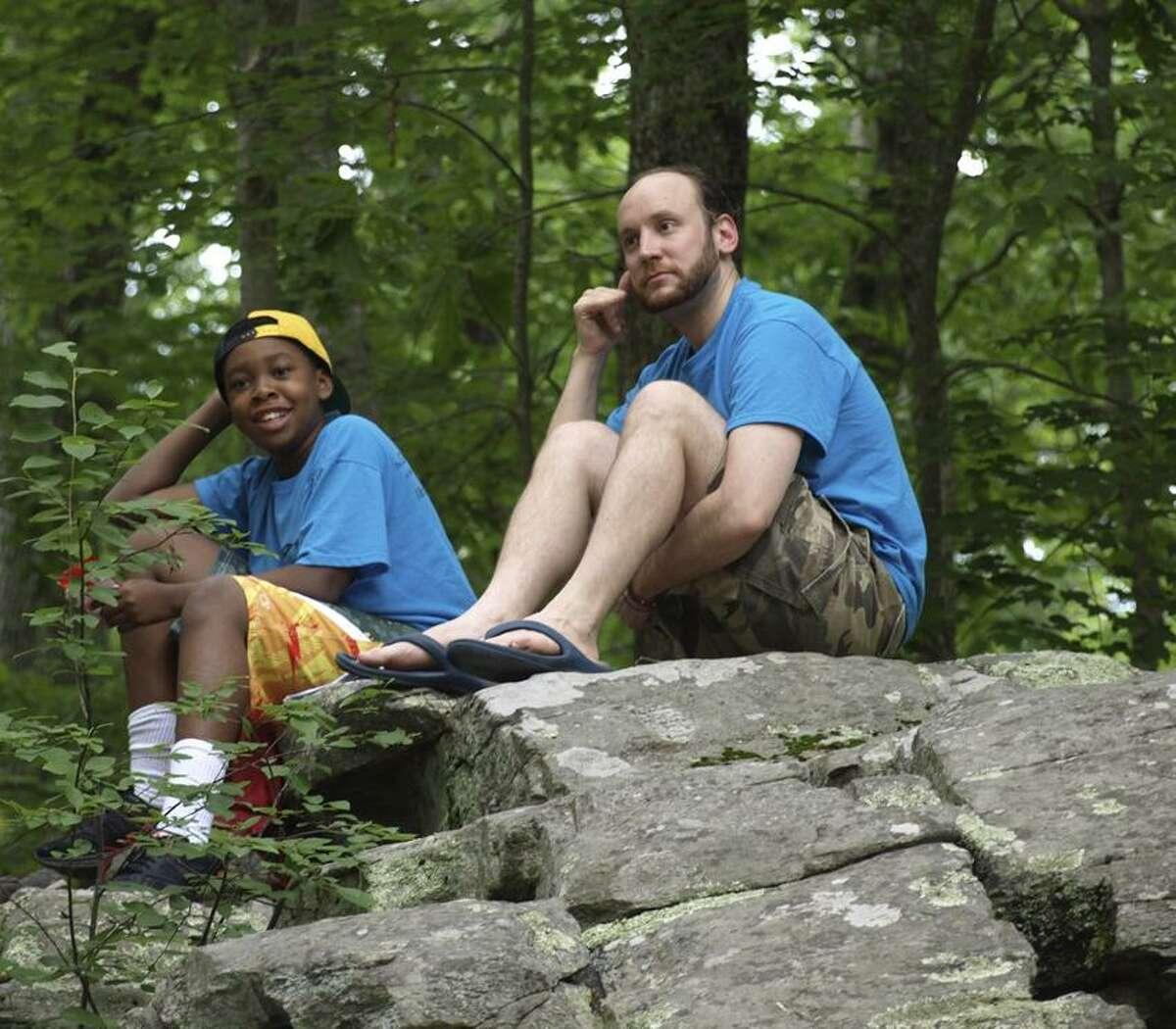 rmfeldman photo: Tyrease Pouncey Jr. and Teaching Artist Michael Walkup, improvise a scene at the Camp Wightman writing retreat.