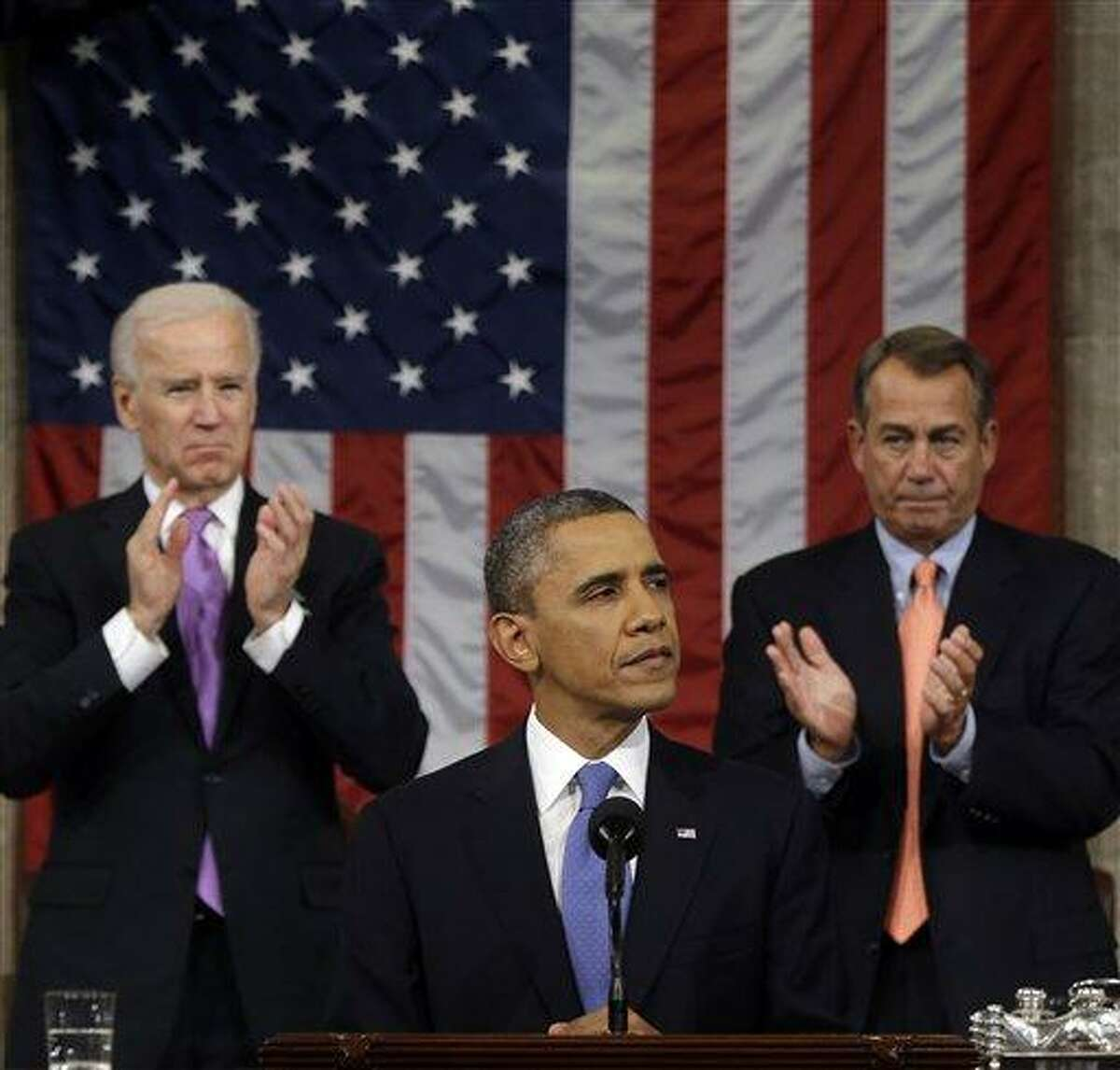 Vice President Joe Biden and House Speaker John Boehner of Ohio applaud President Barack Obama as he gives his State of the Union address during a joint session of Congress on Capitol Hill in Washington, Tuesday Feb. 12, 2013. (AP Photo/Charles Dharapak, Pool)