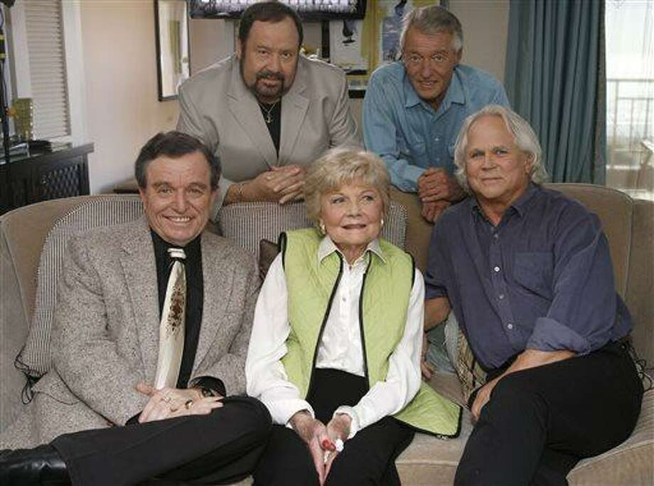 """FILE - In this Sept. 27, 2007 file photo, seated, from left, Jerry Mathers, Barbara Billingsley and Tony Dow, and, standing from left, Frank Bank and Ken Osmond, pose for a photo as they are reunited to celebrate the 50th anniversary of the television show, """"Leave it to Beaver,"""" in Santa Monica, Calif. Bank, who played oafish troublemaker Lumpy on the sitcom """"Leave It to Beaver,"""" has died. A spokesman for the Hillside Memorial Park in Los Angeles said Bank, 71, died Saturday, April 13, 2013. (AP Photo/Damian Dovarganes) Photo: AP / AP"""