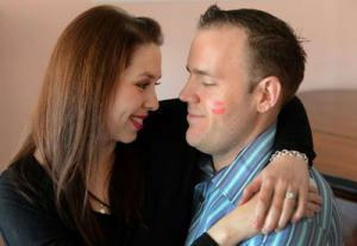 """Jennifer Jones and Scott Wall are photographed at the home where Jones grew up in in Martinez, Calif., on Sunday, Feb. 3, 2013. Wall proposed to Jones by hiring a flash mob at Universal Studios to dance to a Rihanna song much like a proposal on her favorite show, """"Glee."""" (Susan Tripp Pollard/Staff)"""