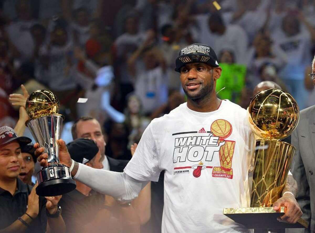 LeBron James holds the MVP trophy and the Larry O'Brien Championship trophy after defeating the San Antonio Spurs in Game 7 of the NBA Finals Thursday.(Steve Mitchell-USA TODAY Sports)
