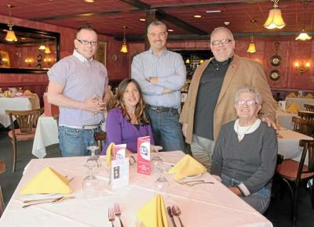 Left to right: Drew Mancuso, Dining Out for Life volunteer ambassador; Tris Perrotti, Consiglio's restaurant co-owner; Christopher Cole, Aids Project New Haven Executive Director; Kenn Hopkins, Dining Out for Life volunteer ambassador; and Marie Apicella, Consiglio's restaurant co-owner; at Consiglio's in New HavenTuesday, April 9, 2013. Photo by Peter Hvizdak / New Haven Register.