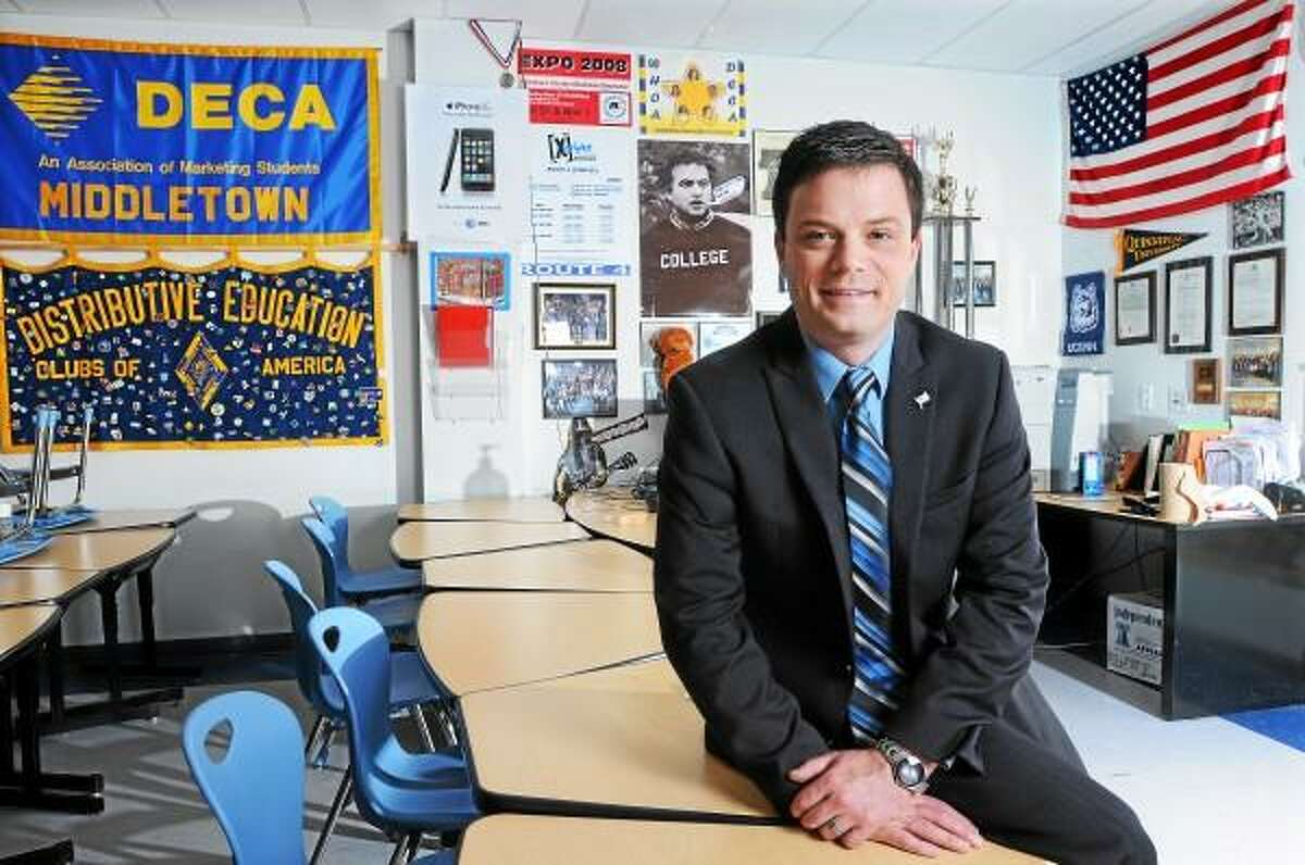 Catherine Avalone/The Middletown Press Dave Reynolds, Coordinator of Career & Technical Education and DECA Advisor at Middletown High School received a service award from Capitol Region Education Council Thursday afternoon for five years of continous online teaching.