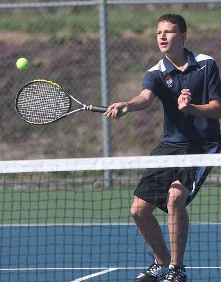 PHOTO BY JOHN HAEGER @ ONEIDAPHOTO ON TWITTER/ONEIDA DAILY DISPATCH Oneida's Jeffrey Coulter returns a shot from Whitesboro's Trevor Kennerknecht during their second singles match at Oneida on Wednesday, April 17, 2013.