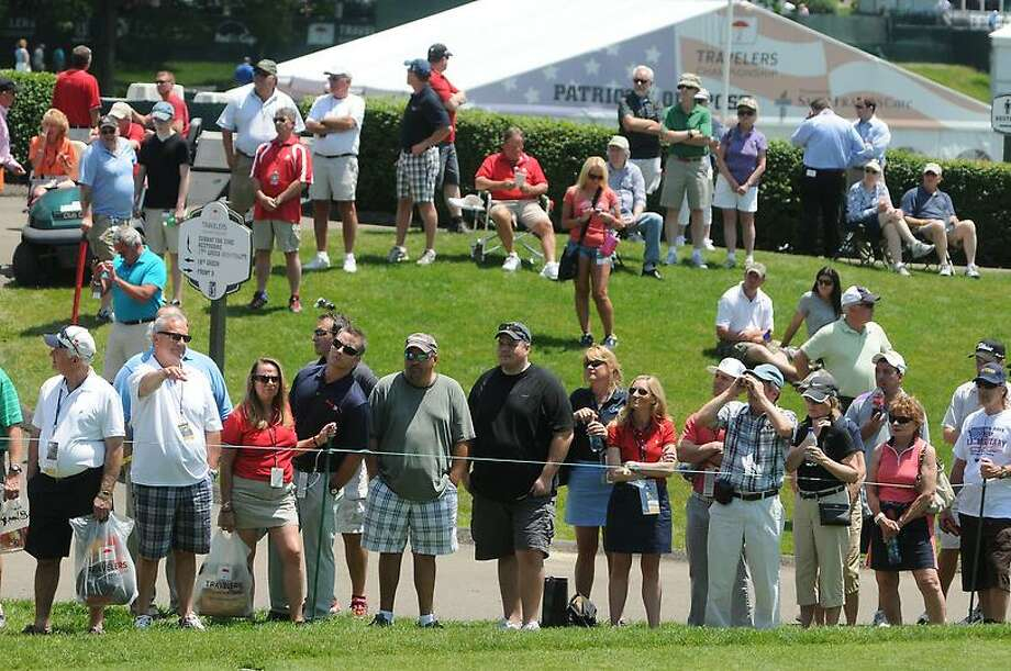 Peter Hvizdak Ñ RegisterCrowd watches Justin Rose on the first tee during the  first round of golf Thursday June 20, 2013  of the PGA  2013 Travelers Championship  at the Tournament Players Club River Highlands in Cromwell, Conn. Photo: New Haven Register / ©Peter Hvizdak /  New Haven Register