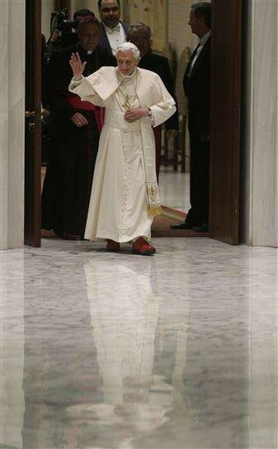 Pope Benedict XVI arrives for his weekly general audience at the Paul VI Hall at the Vatican, Wednesday Feb. 13, 2013. Thousands of people flooded the Vatican's main audience hall Wednesday for Pope Benedict XVI's first public appearance since his bombshell resignation announcement, taking advantage of his second-to-last public audience before retiring at the end of the month. AP Photo/Alessandra Tarantino Photo: AP / AP