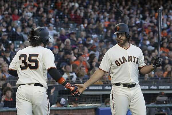 San Francisco Giants' Brandon Crawford (35) is congratulated by Madison Bumgarner after scoring against the Pittsburgh Pirates during the second inning of a baseball game in San Francisco, Tuesday, July 25, 2017. (AP Photo/Jeff Chiu)