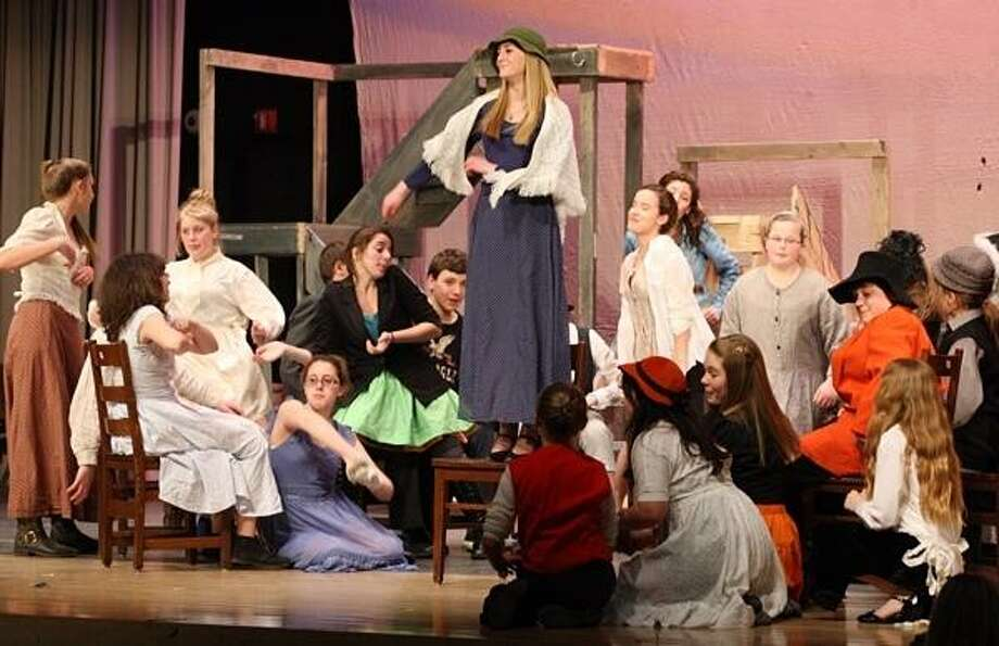 PHOTO BY JOHN HAEGER @ ONEIDAPHOTO ON TWITTER/ONEIDA DAILY DISPATCH Emily Snyder along with fellow cast members rehearse a scene from the production of ??? On Tuesday, April 16, 2013