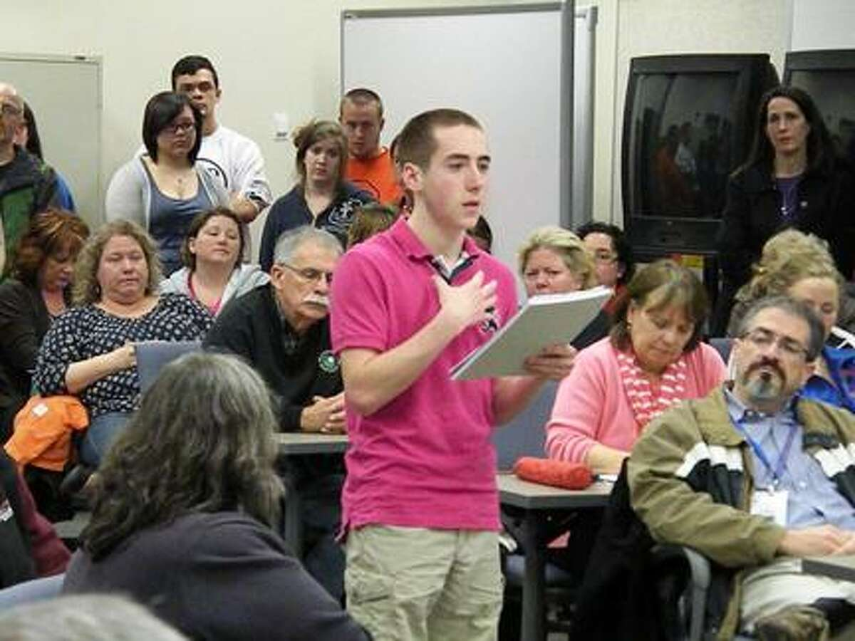 Photo Special to the Dispatch by Michael Yeoman OHS junior Michael McCormick addresses the board about cuts to the music department during a school board meeting Tuesday, April 16, 2013.