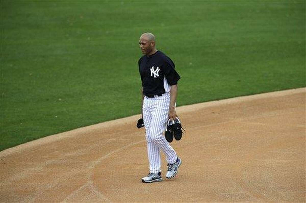 New York Yankees' Mariano Rivera walks the field after a workout at baseball spring training, Wednesday, Feb. 13, 2013, in Tampa, Fla. (AP Photo/Matt Slocum)