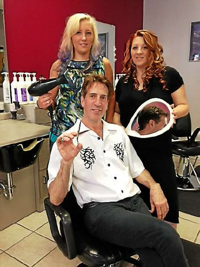 E'clips owner Keith Stegier sits with salon manager Jessica Patrick and employee Ally Liutermoza. Mercy Quaye -- Register Citizen.