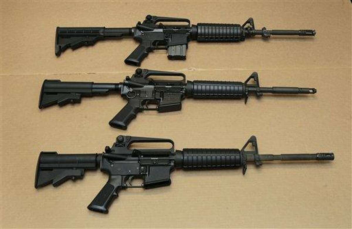 In this Aug. 15, 2012 file photo, three variations of the AR-15 assault rifle are displayed at the California Department of Justice in Sacramento, Calif. AP Photo/Rich Pedroncelli