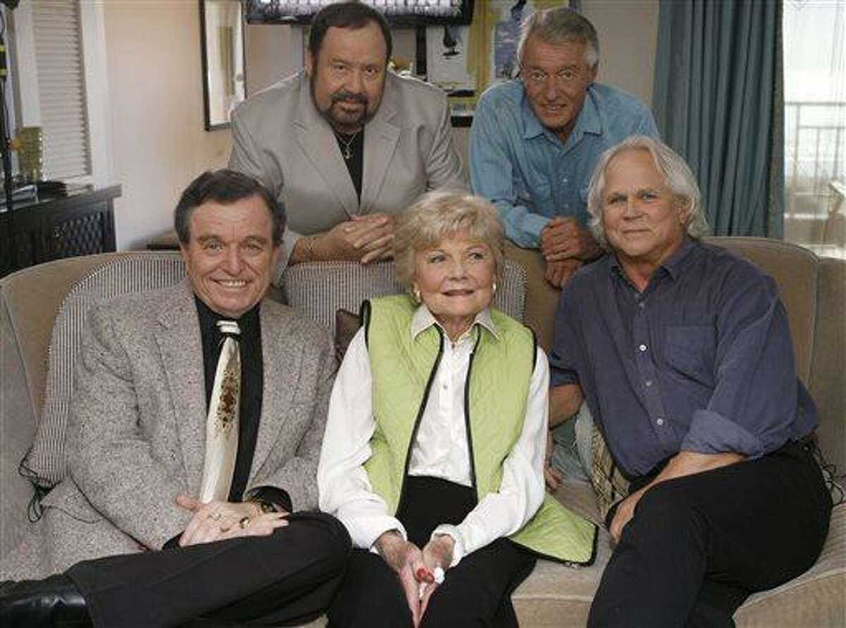 FILE - In this Sept. 27, 2007 file photo, seated, from left, Jerry Mathers, Barbara Billingsley and Tony Dow, and, standing from left, Frank Bank and Ken Osmond, pose for a photo as they are reunited to celebrate the 50th anniversary of the television show,