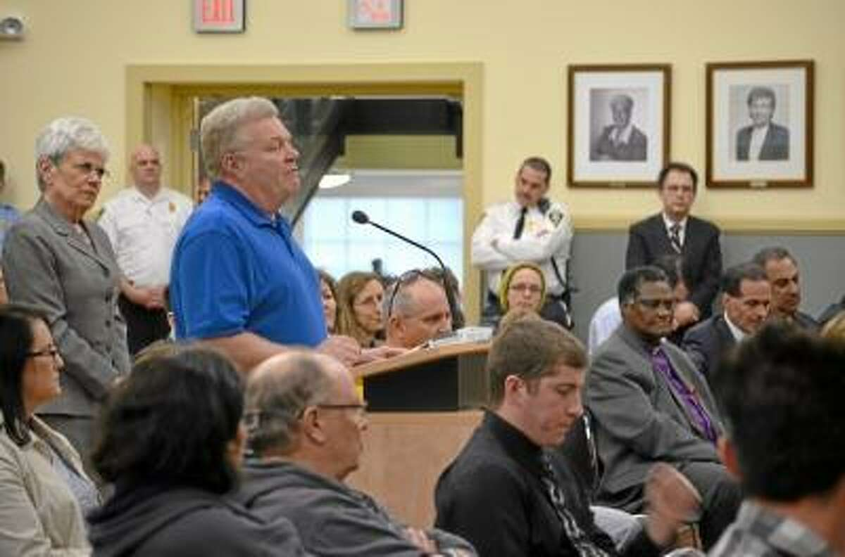 Tom Caprood / Register Citizen -- A resident asks Gov. Dannel P. Malloy a question during a town hall meeting at Torrington City Hall Wednesday.