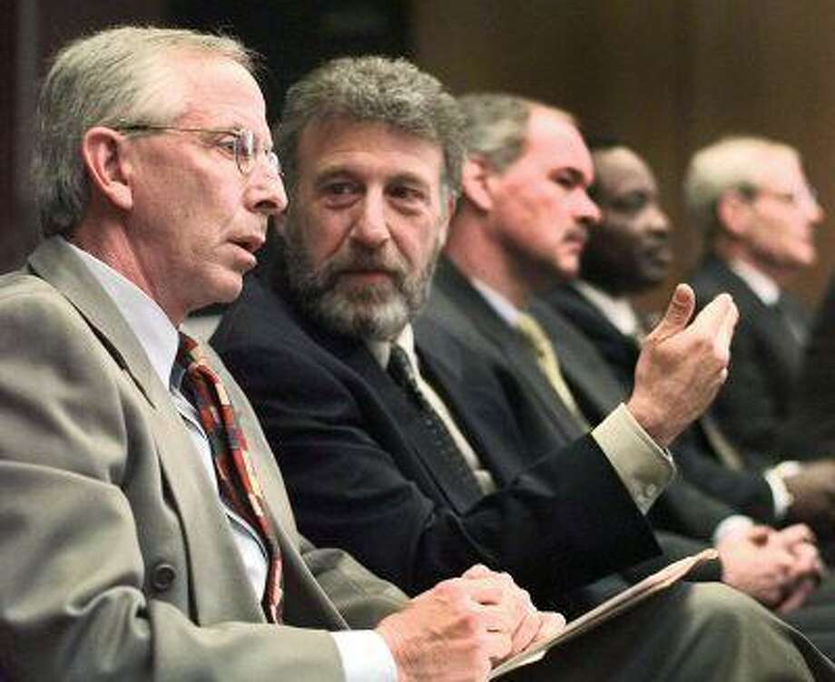 In this Thursday, May 6, 1999 file photo, George Zimmer, second from left, gestures to Andy Dolich prior to a meeting, in Oakland, Calif. (AP Photo/Ben Margot, File) Photo: ASSOCIATED PRESS / AP1999
