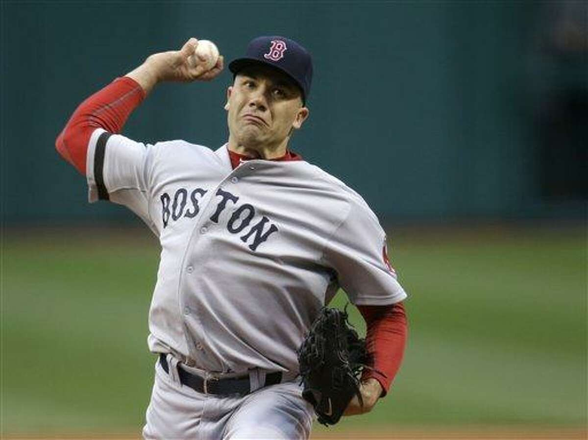 Boston Red Sox starting pitcher Alfredo Aceves delivers against the Cleveland Indians in the first inning of a baseball game Wednesday, April 17, 2013, in Cleveland. (AP Photo/Mark Duncan)