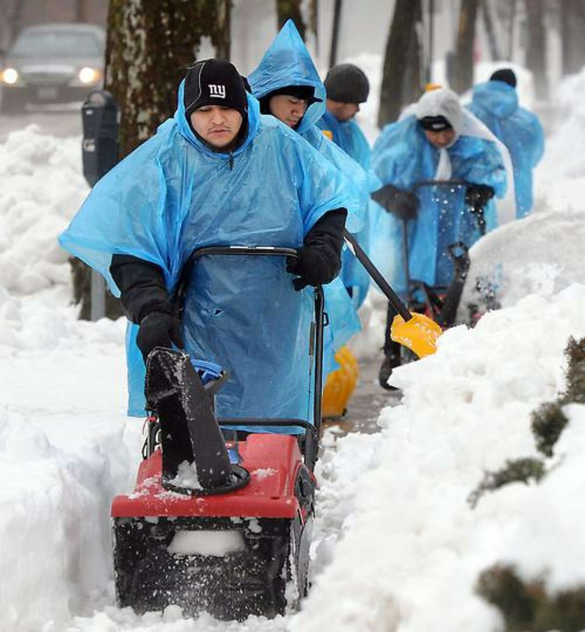 The Blizzard of 2013, Nemo, New Haven. Some of the Yale clean-up crew at work on Temple St. Mara Lavitt/New Haven Register2/11/13