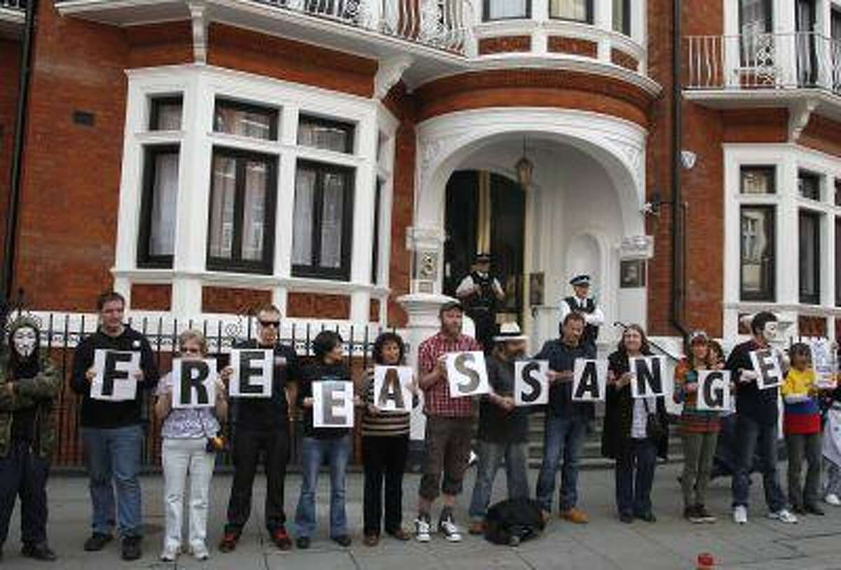 Supporters of WikiLeaks founder Julian Assange stand outside Ecuador's embassy in central London June 16, 2013.