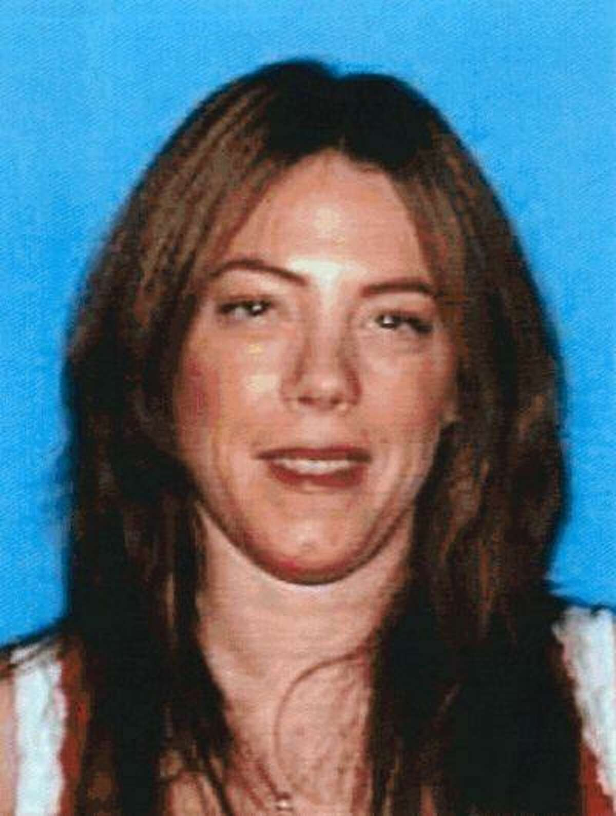 This photo provided by the Department of Motor Vehicles shows Michelle Ann Kane, 43, from the Canoga Park section of Los Angeles, who was killed Saturday, June 15, 2013, one day after she reported to police that her husband had violated a restraining order and vandalized the home they had shared. Michael Rodney Kane, 46, an elementary school teacher accused of chasing down and stabbing his estranged wife to death, was arrested Monday, June 17, 2013. (AP Photo/Department of Motor Vehicles)