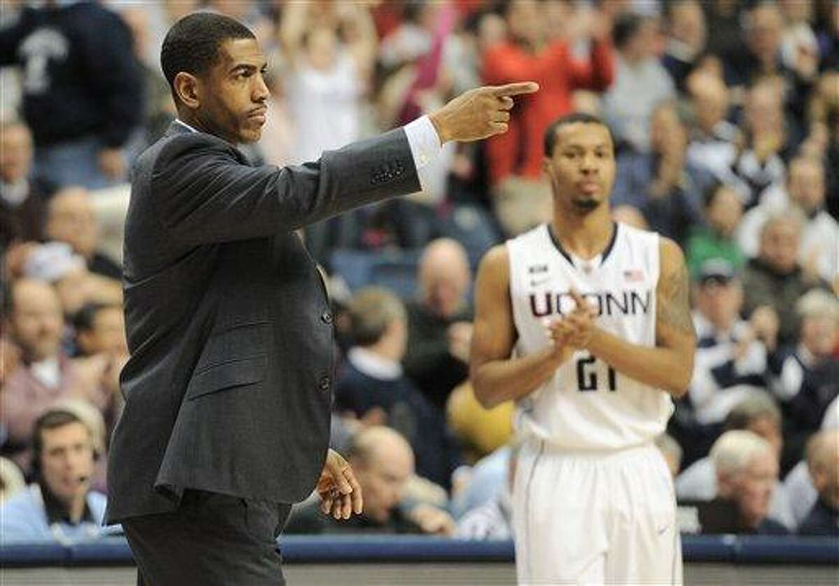Jan. 8, 2013 - Storrs, CT, USA - Tuesday January 8, 2013: Connecticut Huskies Head coach Kevin Ollie points from the sidelines, with Connecticut Huskies guard Omar Calhoun (21) looking on during the 2nd half of the NCAA basketball game between DePaul and Connecticut at Gampel Pavilion in Storrs, CT. Connecticut went on to win easily 99-78. Bill Shettle / Cal Sport Media. (Cal Sport Media via AP Images)