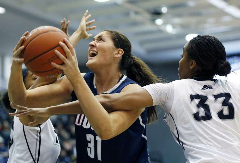 Connecticut's Stefanie Dolson (31) tries to shoot between Providence's Brianna Edwards (33) and Alexis Harris, left, in the first half of an NCAA college basketball game in Providence, R.I., Tuesday, Feb. 12, 2013. (AP Photo/Michael Dwyer) Photo: AP / AP
