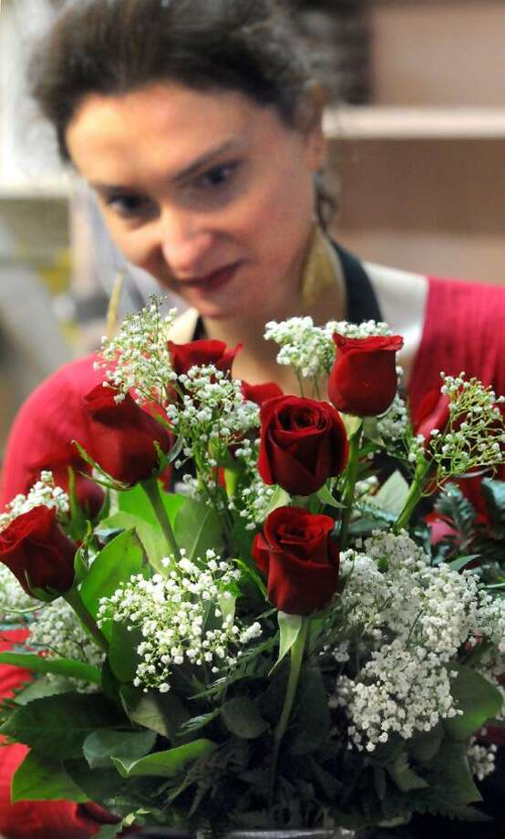West Haven: Sarah Lathrop of New Haven, Farricielllii's Flowers by Ginger's floral designer, puts together a Valentine's Day bouquet. Florists are concerned about how the storm will affect Valentine's Day orders and sales since so many customers were snowed in. Mara Lavitt/New Haven Register2/12/13