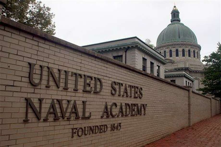 """FILE - This is a May 7, 2007 file photo showing the United States Naval Academy in Annapolis, Md. The U.S. Naval Academy is investigating allegations that three members of its football team sexually assaulted a female midshipman at an off-campus house last year, a Pentagon spokesman said Friday, May 31, 2013, and a lawyer for the woman says she was """"ostracized"""" on campus after she reported it.  (AP Photo/Kathleen Lange, File) Photo: AP / AP"""