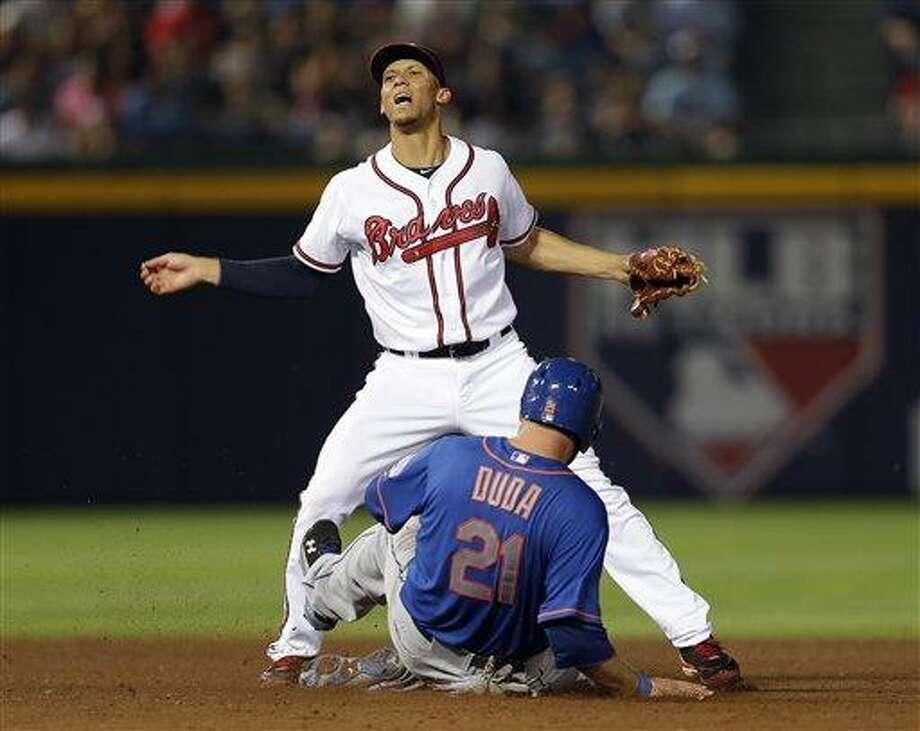 Atlanta Braves shortstop Andrelton Simmons (19) forces on New York Mets left fielder Lucas Duda (21) in a baseball game Wednesday, June 19, 2013 in Atlanta.  (AP Photo/John Bazemore) Photo: AP / AP