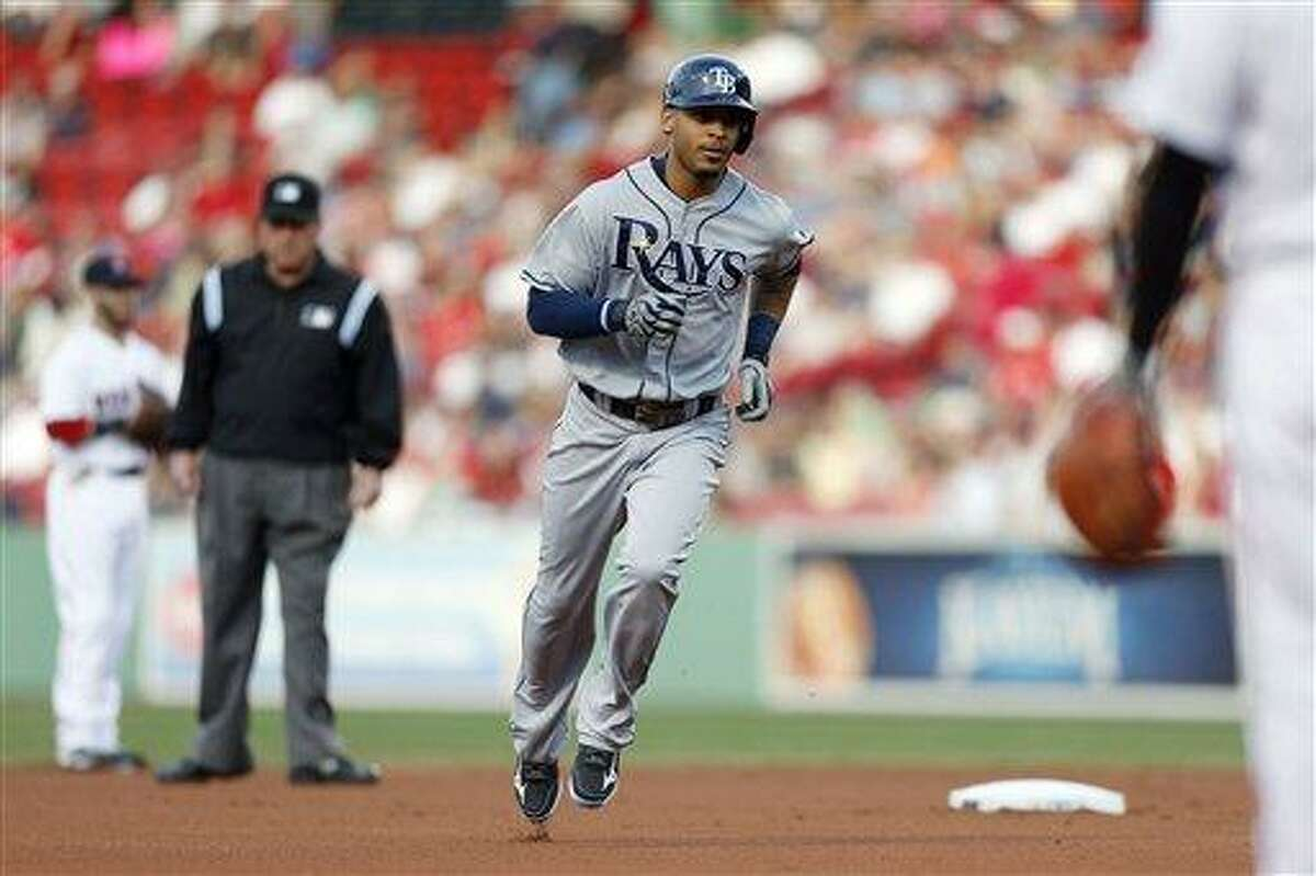 Tampa Bay Rays' Desmond Jennings rounds second base on a solo home run in the first inning of a baseball game against the Boston Red Sox in Boston, Wednesday, June 19, 2013. (AP Photo/Michael Dwyer)