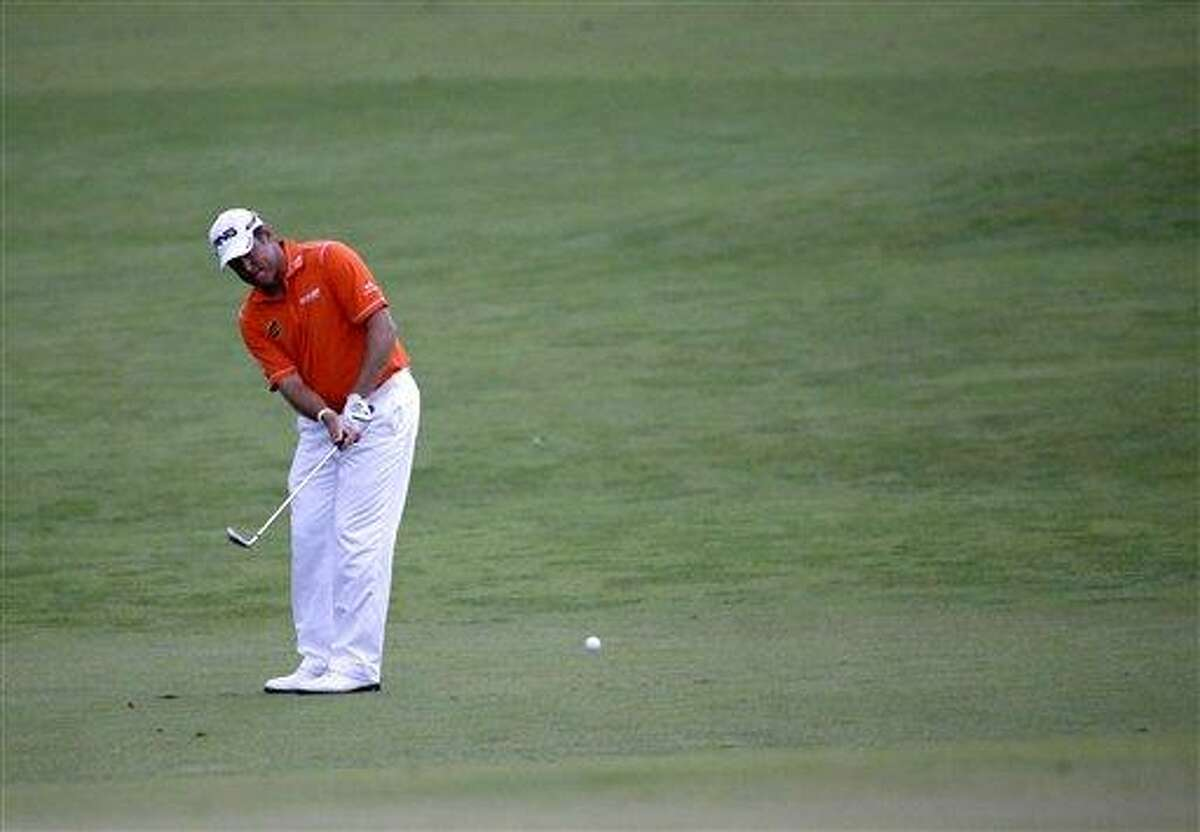 Lee Westwood, of England, hits on the 12th hole during the first round of the U.S. Open golf tournament at Merion Golf Club, Thursday, June 13, 2013, in Ardmore, Pa. (AP Photo/Morry Gash)