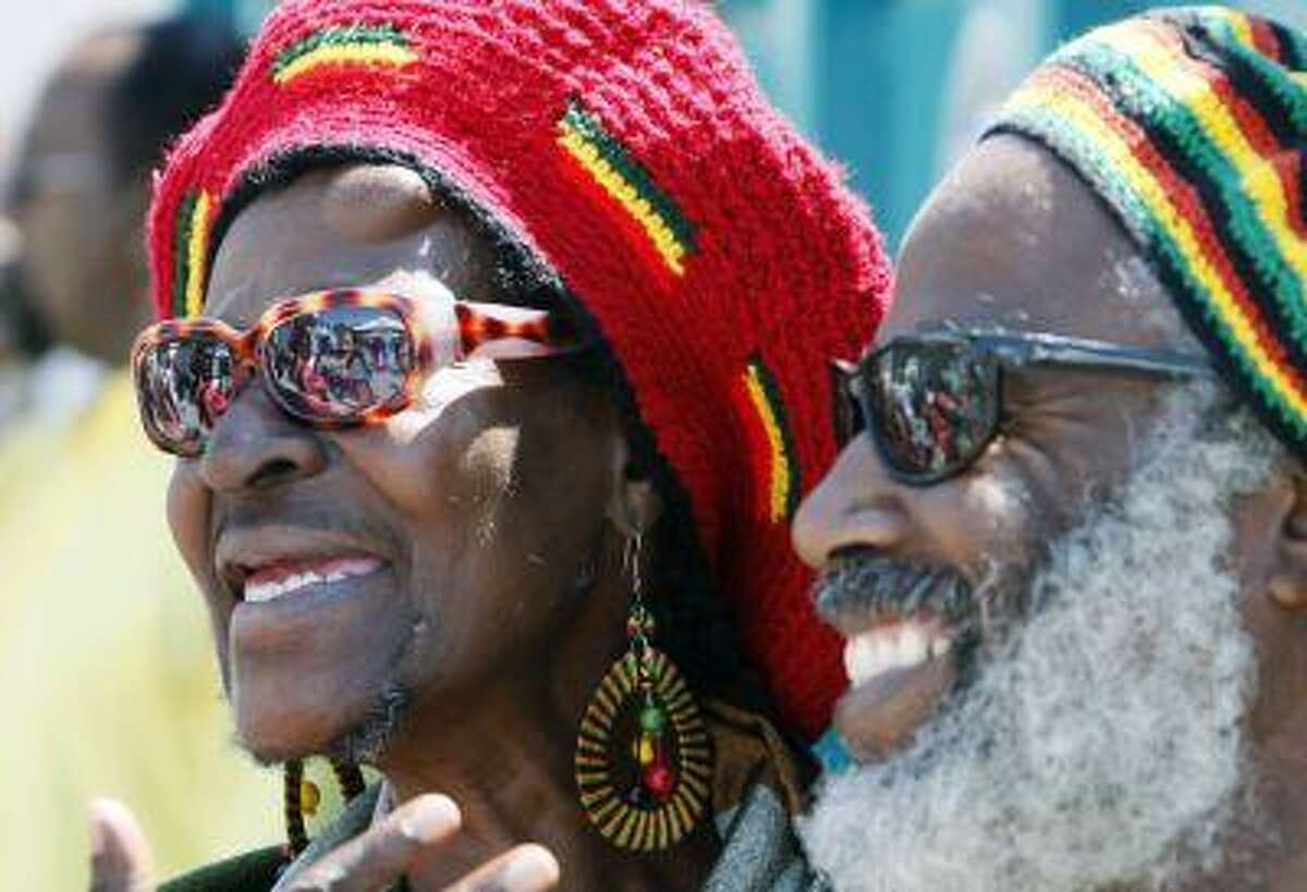 Deborah Smith and her husband Kuma watch festivities at a Juneteenth celebration at Leimert Park in the Crenshaw District of Los Angeles Saturday, June 19, 2010. (AP Photo/Reed Saxon)