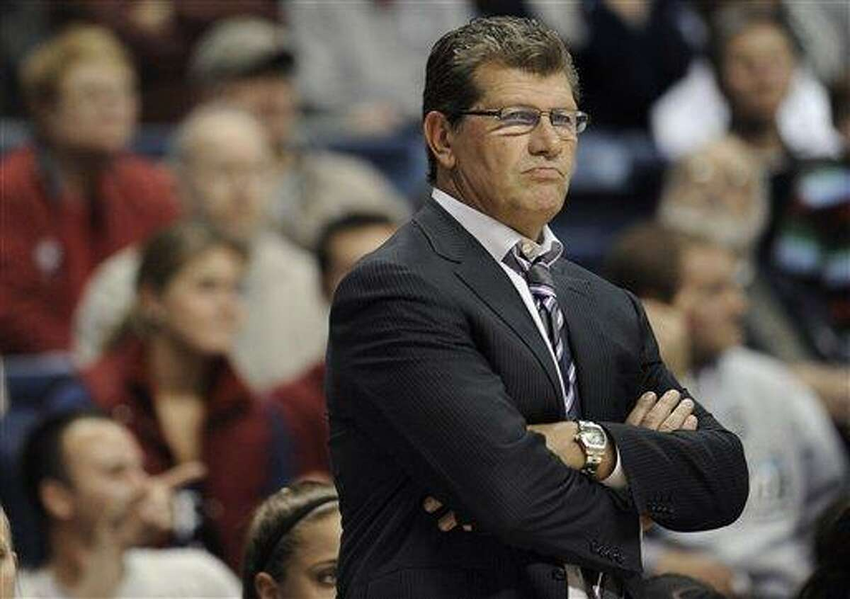 Connecticut head coach Geno Auriemma watches play during the first half of an NCAA college basketball game against Penn State in Storrs, Conn., Thursday, Dec. 6, 2012. (AP Photo/Jessica Hill)