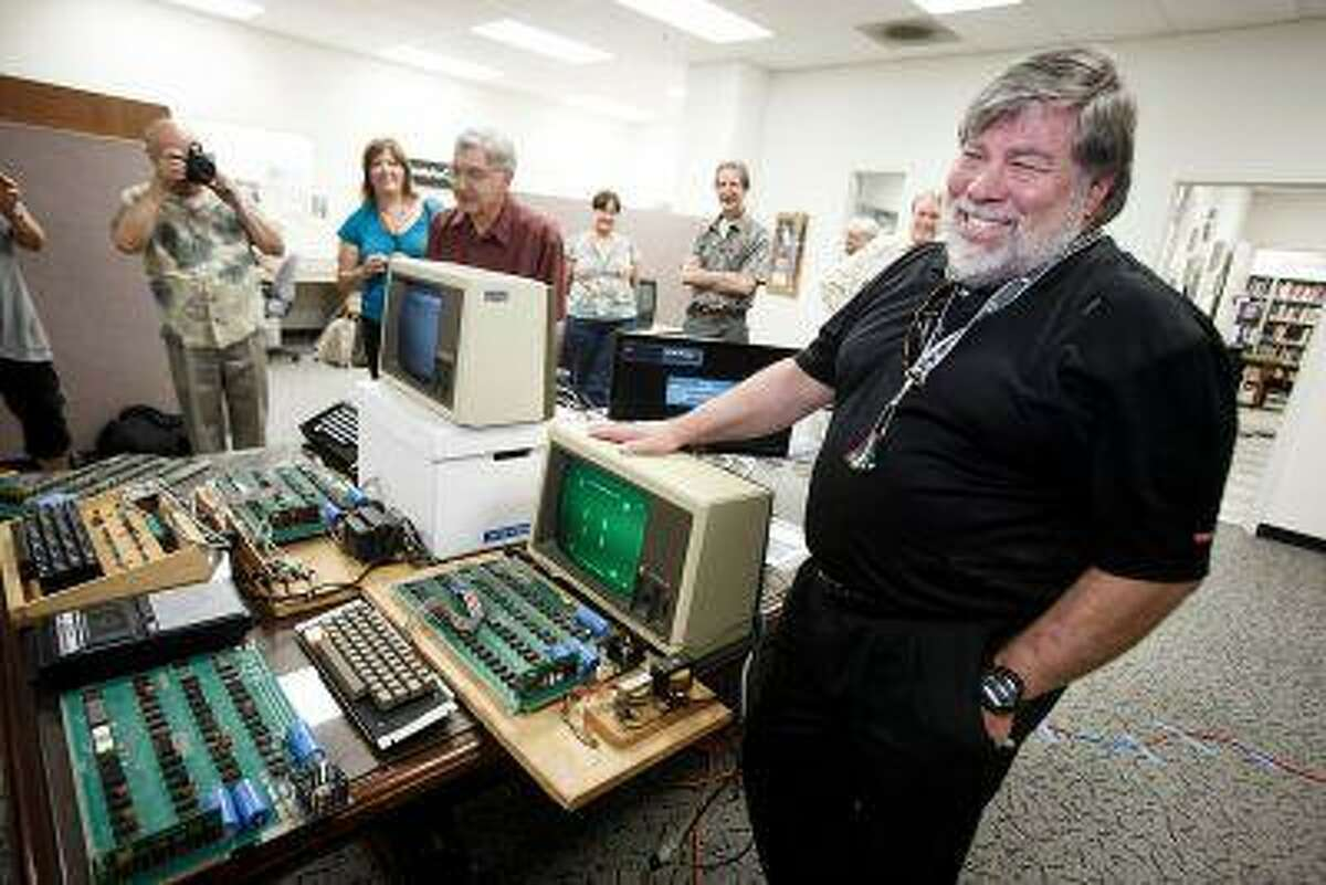 Steve Wozniak, co-founder of Apple, stands behind five Apple 1 computers for a photo op on June 18, 2013 at History San Jose. (Dai Sugano/Bay Area News Group)