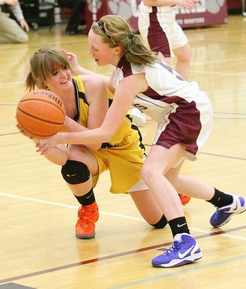Dispatch Staff Photo by JOHN HAEGER (Twitter: @OneidaPhoto) Otselic Valley's Elyse Peterson (44) and Stockbridge Valley's Jordyn Sanford (5) battle for a loose ball in the first half of their game in Munnsville on Tuesday, Feb. 12, 2013. Photo: Oneida Daily Dispatch / Oneida Daily Dispatch