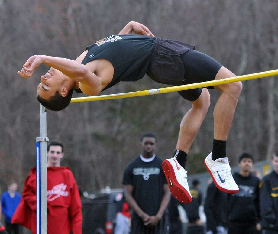 """Amity's David Karabinos clears 5'6"""" in the high jump event Tuesday. Karabinos won the event by jumping 6 feetPhoto-Peter Casolino/Register  <a href=""""mailto:pcasolino@newhavenregister.com"""">pcasolino@newhavenregister.com</a>."""