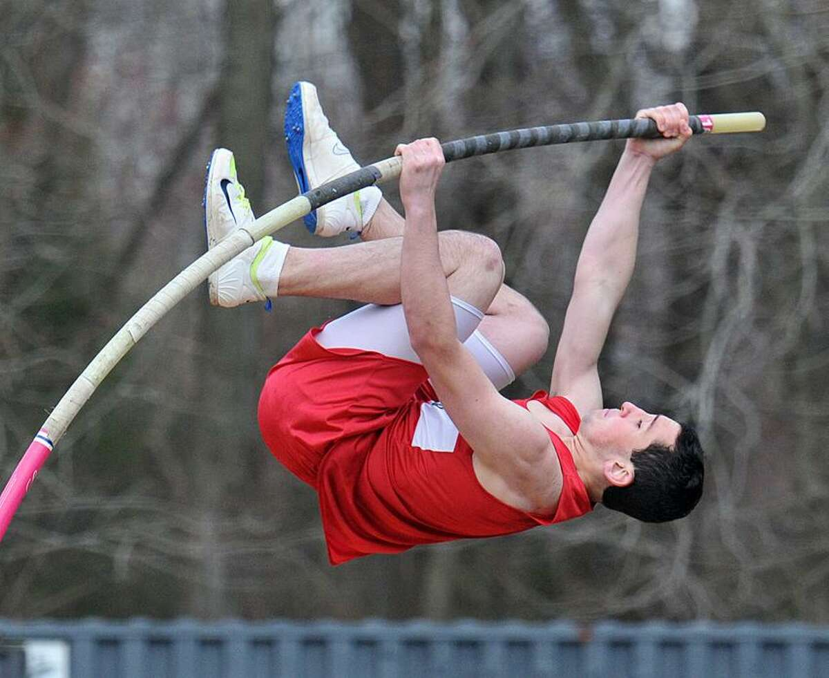 Branford's Denis Daly tries for 13' 1