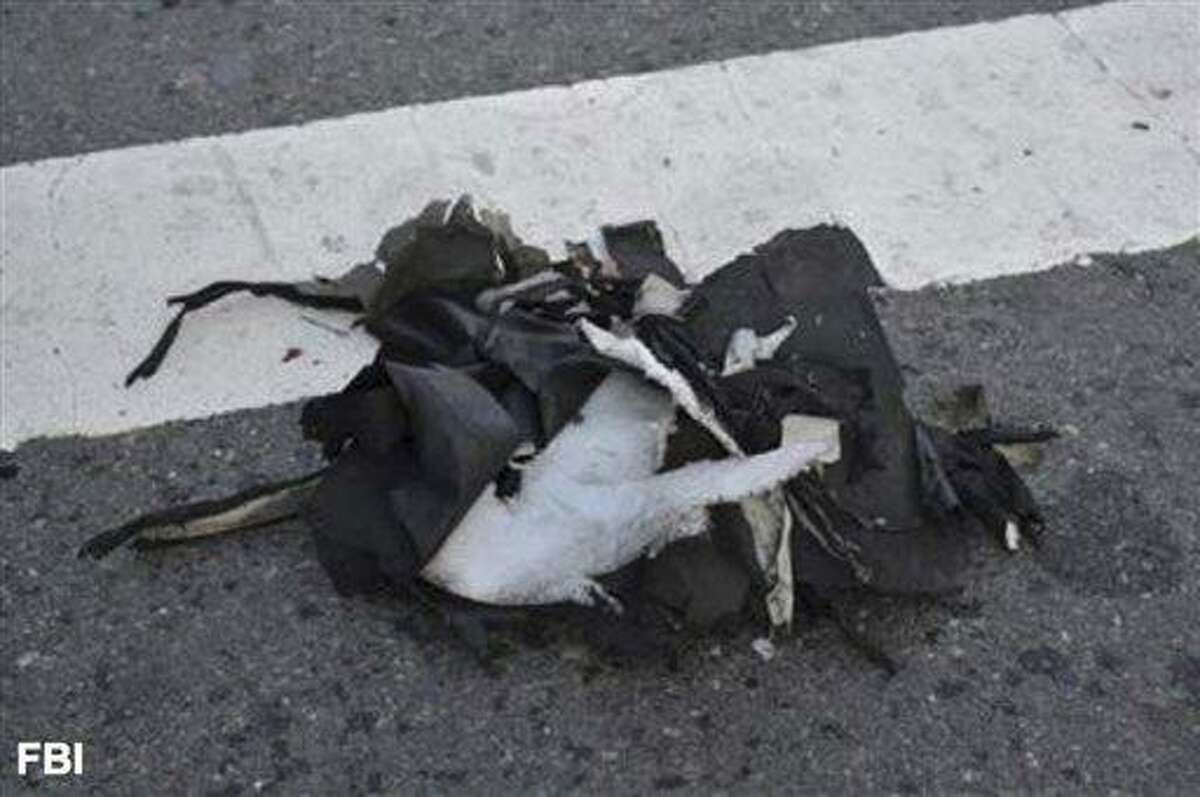 This image from a Federal Bureau of Investigation and Department of Homeland Security joint bulletin issued to law enforcement and obtained by The Associated Press, shows the remains of a black backpack that the FBI says contained one of the bombs that exploded during the Boston Marathon. The FBI says it has evidence that indicates one of the bombs that exploded in the Boston Marathon was contained in a pressure cooker with nails and ball bearings, and it was hidden in a backpack. (AP Photo/FBI)