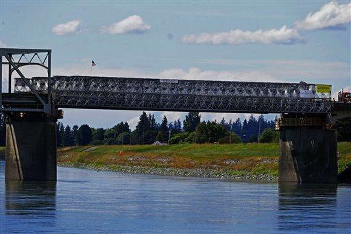 This Tuesday, june 18, 2013 photo shows the Interstate 5 bridge over the Skagit river, which is scheduled to reopen tomorrow, Wednesday June 19. (AP Photo/The Seattle Times, Mark Harrison) OUTS: SEATTLE OUT, USA TODAY OUT, MAGAZINES OUT, TELEVISION OUT, SALES OUT. MANDATORY CREDIT TO: MARK HARRISON / THE SEATTLE TIMES