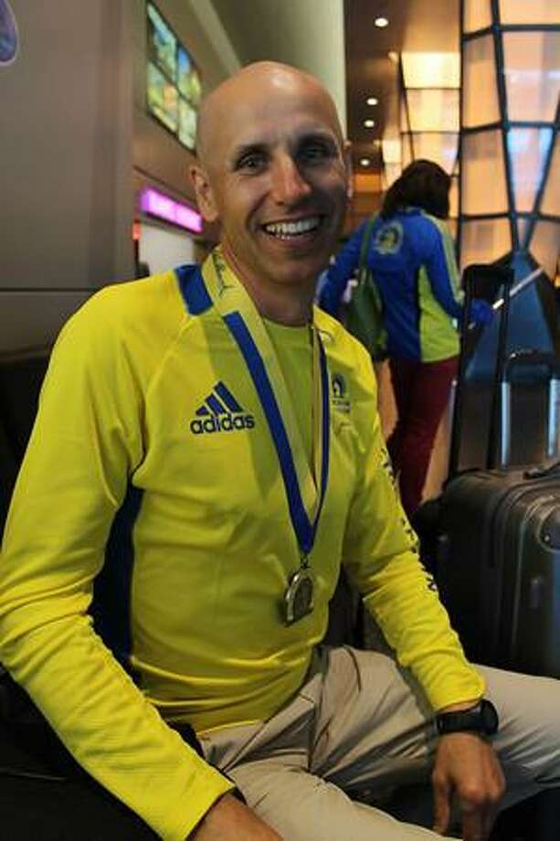 """Meet Arunas Kumpis, a marathoner from Vilnius, Lithuania. Kumpis said he was saddened by yesterday's tragedy but smiled when he was asked about his time in Boston. """"The best,"""" he said about the city's people, adding that nothing would keep him from coming back."""